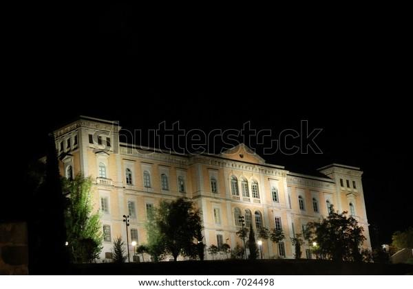 Building illuminated at night, Toledo, Spain
