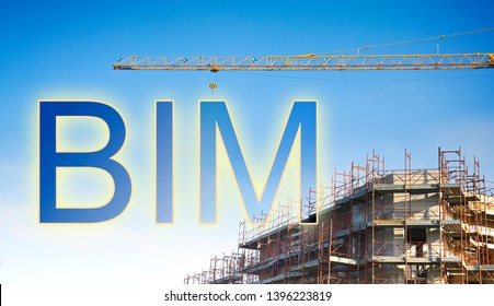 Building Information Modeling (BIM), a new way of architecture designing - concept image with a metal tower crane in a construction site with hanging text BIM.