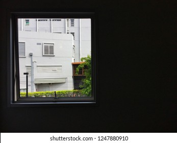 Building inside window frame take a shot in the darkroom