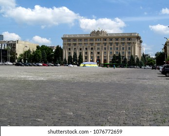 The building of the Kharkiv Region State Administration on the Svobody square, Kharkov, Ukraine. The building in the style of the postwar Stalinist Empire on a summer sunny day against the blue sky