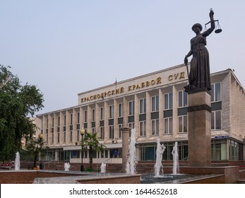 """The building of the Krasnoyarsk Regional Court from a height in the summer. The inscription on the building: """"Krasnoyarsk Regional Court."""" Monument to a woman judge with scales and a fountain."""