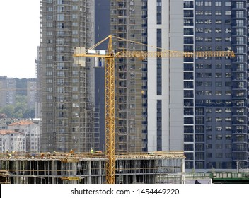 Building of large modern apartment scraper with glass windows on the construction site