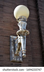 Building light on a brick building - rust on metal - Wells Fargo, Baudette, MN