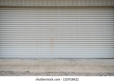 Building made of concrete with roller shutter door