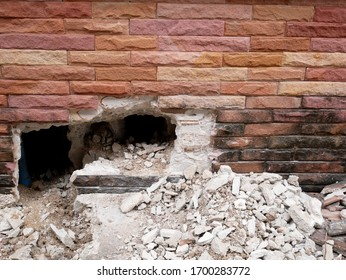building is making hole in wall at construction site