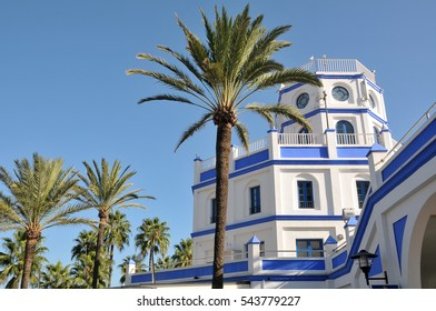 Building of the Marina of Estepona, between palm trees, coast of the province of Malaga, Andalusia, Spain