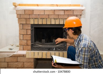Building Master Examines A New Fireplace
