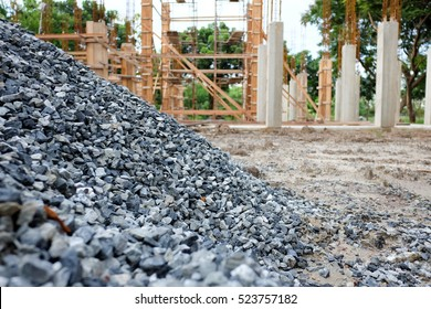 Building materials,gravel stone, with construction in background.