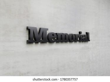 A building metal signage that says 'Memorial'.