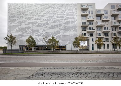 The building of a modern parking lot and an apartment building in Copenhagen