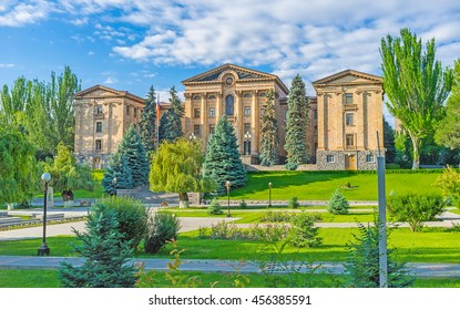 The building of National Assembly of Armenia (Parliament), surrounded by large garden, Yerevan, Armenia.