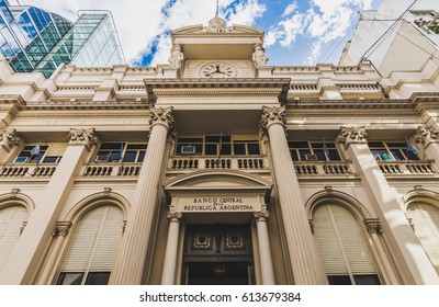 Building of the National Bank of Argentina in Buenos Aires on a sunny day against blue sky with white clouds. Photo stylized for film look