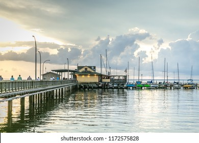 Building on Pier at Sunset in Fairhope, Alabama