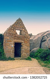 Building on Pink Granite Coast in Perros-Guirec - known for its pink granite rocks which have been sculpted by the sea into varied shapes and patterns, Ploumanach, Brittany, France