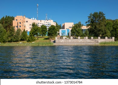 Building on the shore of a forest lake on a summer day