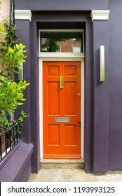 Building with orange door in London.