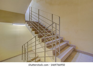 Building panel house interior with entryway and flight stairs. Precast concrete staircase. Flight of stairs. Flight of stairs are decorated building. Beautiful long staircase. Tile on floor.