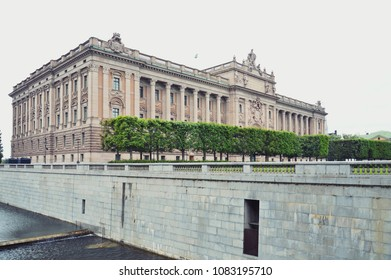 Building of The Parliament House in Neoclassical style, with centered Baroque Revival style facade section, located on nearly half of Helgeandsholmen island, in Gamla stan, old town Stockholm, Sweden