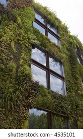 Building with plants growing on its external facade