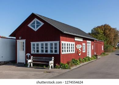 Building of the port authority of the Little Danisch harbour Harboelle Havn at the island Moen in the traditional kind of red and white painted wood