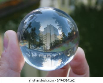 Building reflected backwards in a lake and with the glass ball, its reflection was perfect!