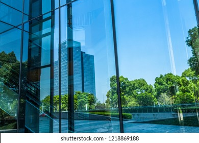 building reflected in Windows of Modern Office Building