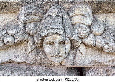 Building relief detail of architectural frieze with human head in Aphrodisias (Turkey) build during Roman period.