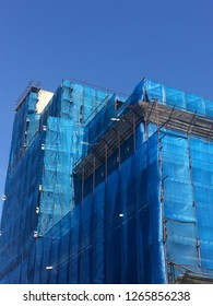 building renovation, blue cover and blue sky