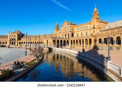 Building and river at the Spain Square (Plaza de Espana) in Seville (Sevilla) city, Andalusia, Spain. Example of Moorish and Renaissance revival. Bright Sunny day