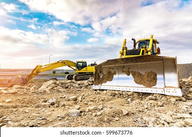 Building a road with varied machinery