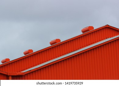 Building roof siding made with corrugated sheet metal, painted in bright color