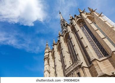 building of  Sainte-Chapelle chapel against blue sky and cloud in Paris