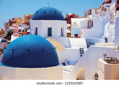 Building in Santorini Greece with  blue roofs and colourfull scenery