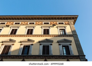 Building with shadow and blue sky in background.