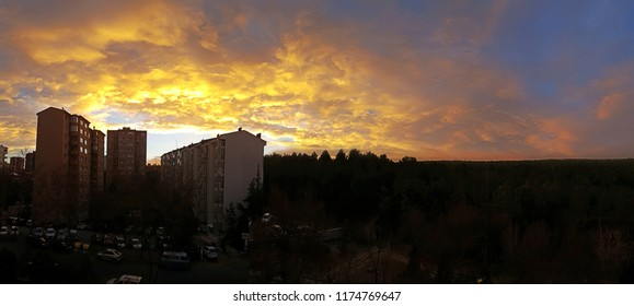 A Building Silhouette at Sunset with colourfull orange  sunset Clouds