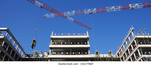building site with crane and blue sky, panoramic view