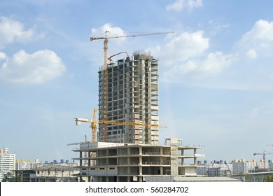 building site with cranes and blue sky