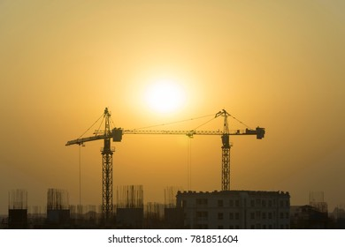 Building site with cranes and blue sky on everning