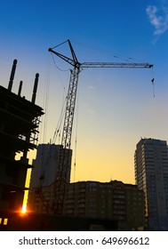 Building site and cranes on sunset