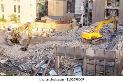building site with heavy machinery knocking down a building to make way for something new