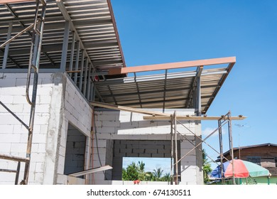 Building Site With House Under Construction with blue sky
