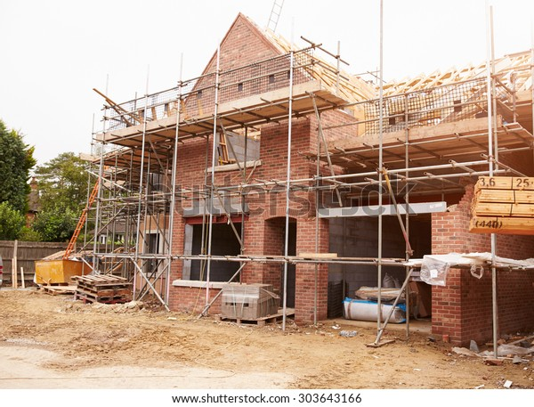 Building Site With House Under Construction