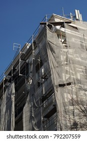 Building site with protective nets at construction site high-rise buildings