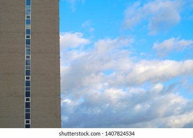 building skyscraper blue sky clouds background vertical urban