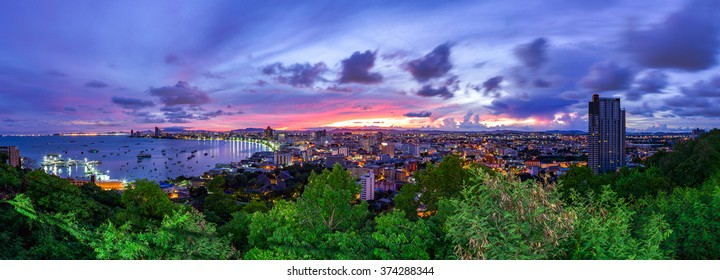 The building and skyscrapers in twilight time, Pattaya,Thailand. Pattaya city is famous about sea sport and night life entertainment. (Panorama view)