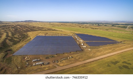 Building solar power station in agriculture field. Beautiful aerial view at summer cloudless day