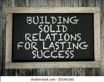 Building Solid Relations For Lasting Success written on chalkboard