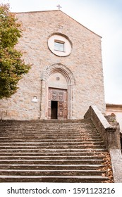 Building and stone steps leading to the church of Saint Francis in Cortona Tuscany Italy.