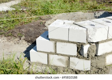 Building stones on foundation at the construction site