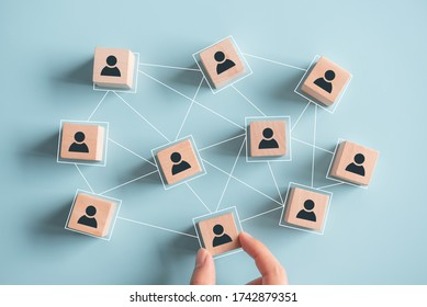Building a strong team, Wooden blocks with people icon on blue background, Human resources and management concept.